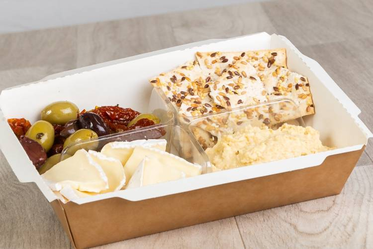 This perfect graze snack contains fresh olives  sundried tomato, silky brie slices, reduced fat houmous and crunchy thin crackers