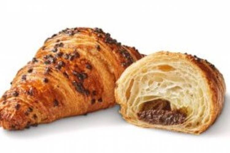 Delicious golden brown butter croissant filled with Belgian chocolate and topped with hazelnut sprinkles