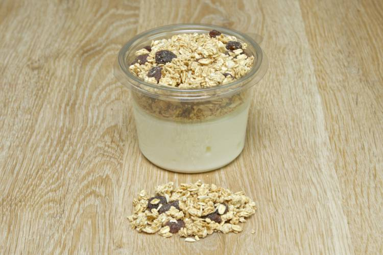 A mixed berry base, covered with low fat Greek natural yoghurt, and a granola cereal topper